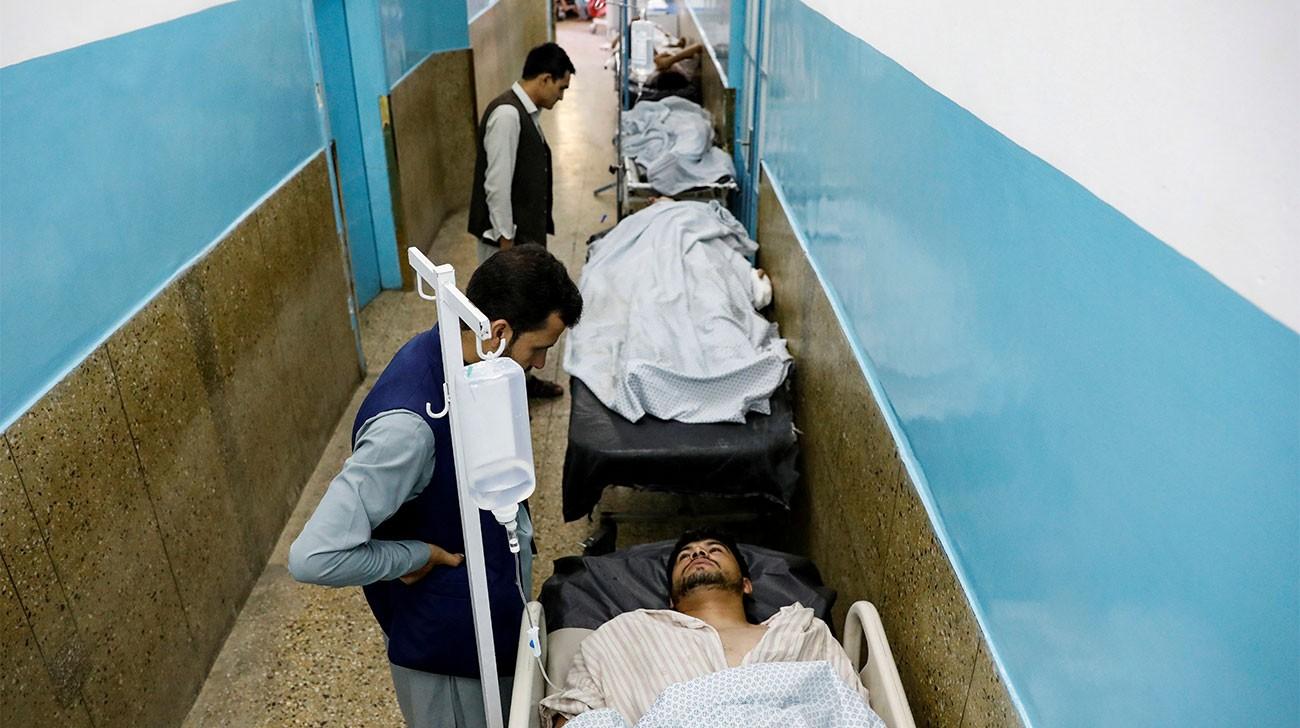 Afghan wedding suicide blast kills 63, amid hopes for talks 20