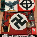 Italian police handout shows weapons and a Nazi flag with a swastika that they say were seized in searches of properties of an extreme right group who planned to create a new Nazi party, in an unidentified location in Italy