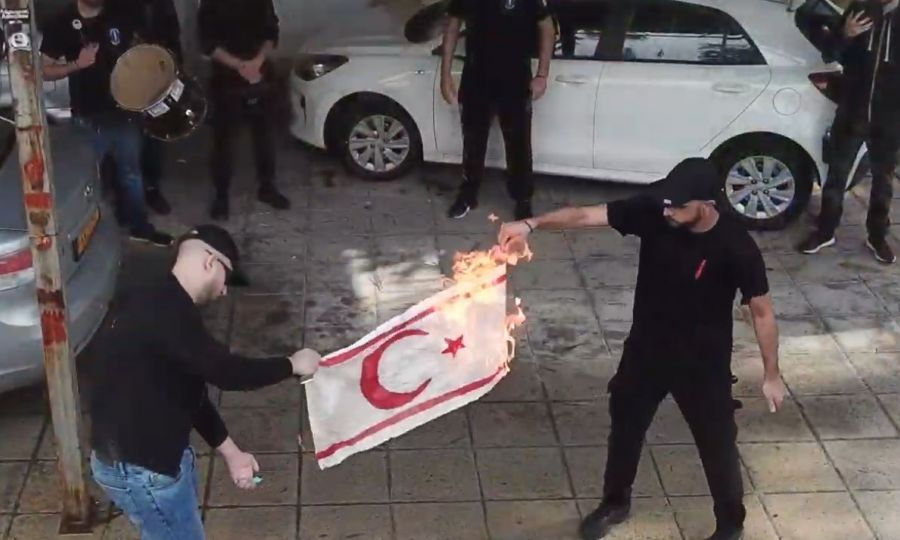 North says flag burners in the south identified 1