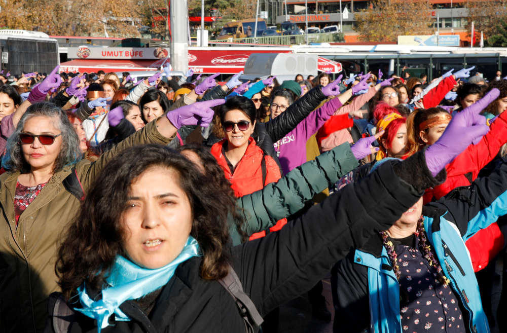 Women perform the Chilean anti-rape song during a demonstration against gender violence in Istanbul, Turkey December 15, 2019. REUTERS/Kemal Aslan
