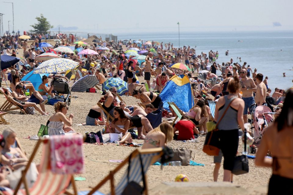 Sunseekers packed Southend beach as the heatwave challenged social distancing rules. (Video) 16