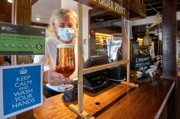 Health minister hails responsible behavior after English pubs reopen 9