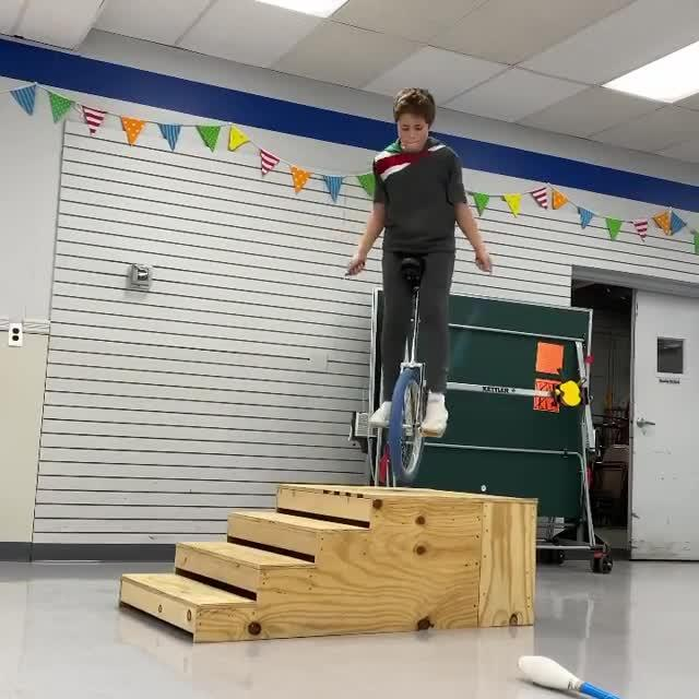 Boy Does Skipping While Riding Unicycle on Wooden Ramp