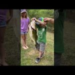 Boy Overjoyed After Catching Large Bass Out of Pond