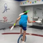 Boy Practices Juggling Trick While Riding Unicycle During Quarantine