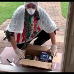 Dad Dresses Up in DIY Protective Gear to Retrieve Package Delivered to Front Door