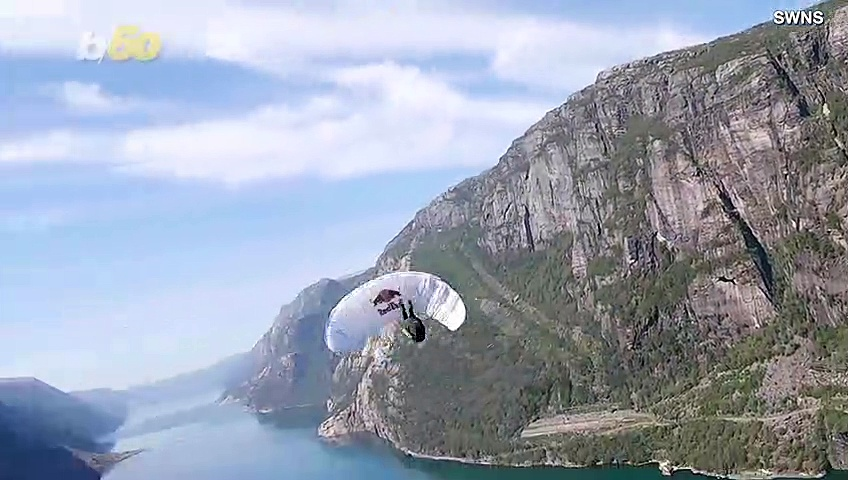 Flipping Out! Watch This Acro-Paraglider Performing His Dangerous 'Infinity Tumbling' Stunt!