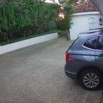 Girl Rams Car into Garage Door Snapping It in Half