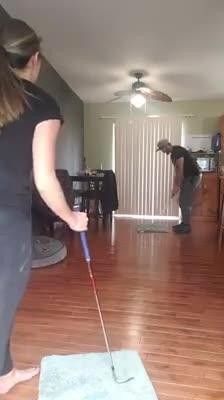 Golfer Couple Plays Golf In Their Living Room During Quarantine