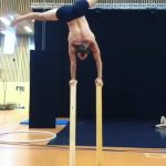 Guy Balances on Wooden Blocks While Doing Handstand
