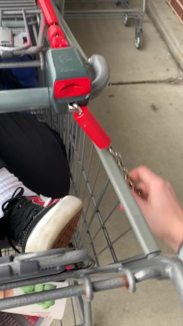 Guy Carries Friend in Shopping Cart out of Store and Locks him With Other Carts