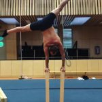 Guy Does One Arm Handstand Over Block of Wood