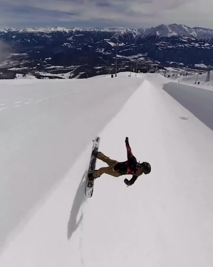 Guy Does Snowboarding Tricks on Snow Ramp