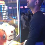 Guy Fails While Playing Claw Arcade Game