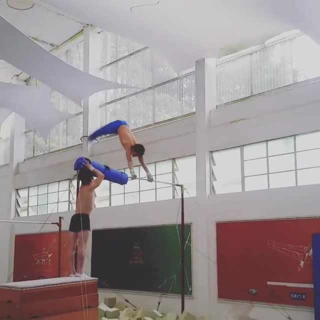 Guy Hits Neck on Horizontal Bar While Practicing Gymnastic Routine