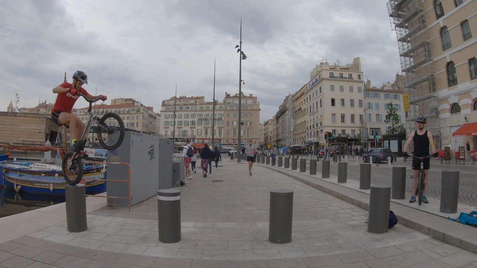 Guy Jumps Bike Over Bollards on Pavement
