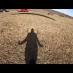Guy Lands Near Parked Cars Post Paragliding