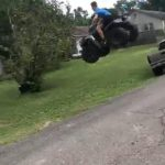 Guy On ATV Attempts Jumping Across Road and Falls Headlong