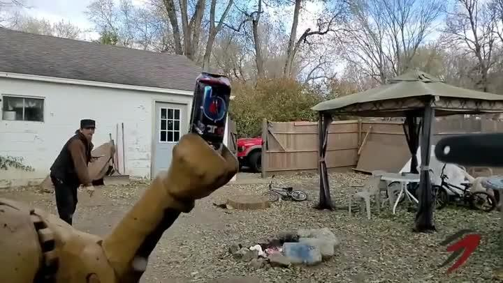 Guy Successfully Throws Blade at Can From Distance