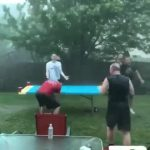 Guys Try to Play Beer Pong During Heavy Rainstorm