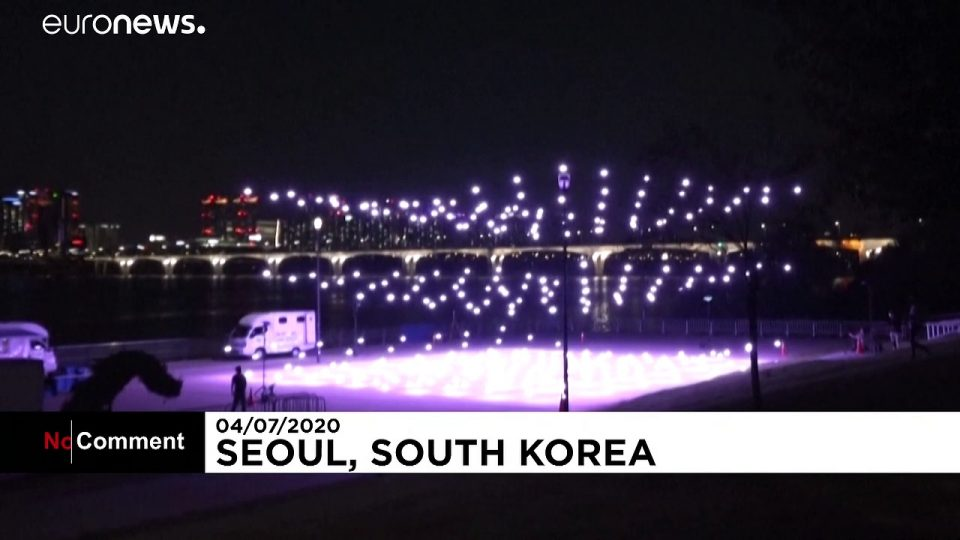 Hundreds of drones light up South Korean sky with virus messages