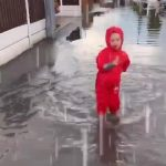 Kid Dances in Flooded Street