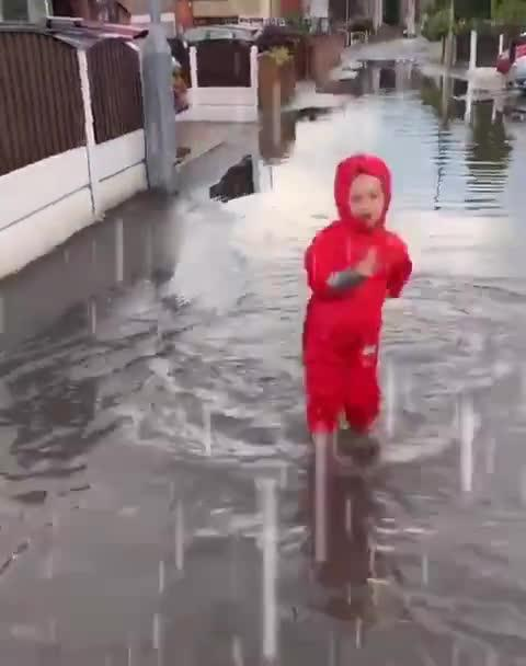 Kid Dances in Flooded Street