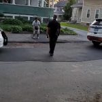 Kid Plays Basketball With Police Officer