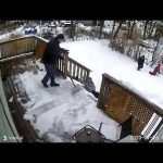 Kid Slips Down Snow Covered Steps While Shovelling Snow