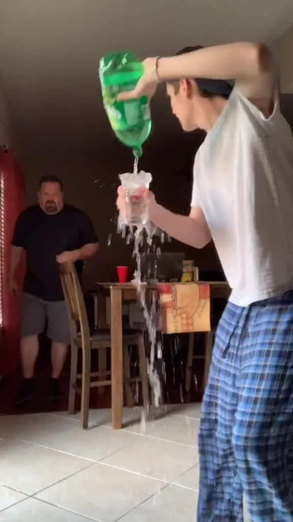 Man Gets Angry and Bursts out on son Pouring Cold Drink out of Glass on Floor