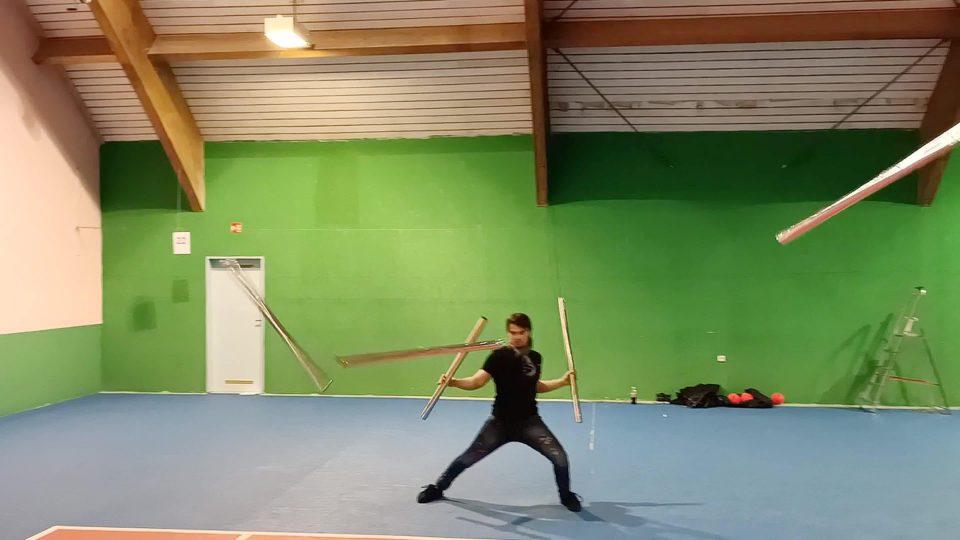 Man Performs Incredible Juggling Tricks With Metal Rods