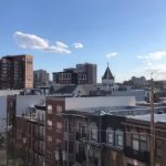 Man Tosses Football from His Rooftop to Neighbor's Across the Street