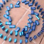 Mint Tins Spelling Out COVID 19 Fall With Domino Effect
