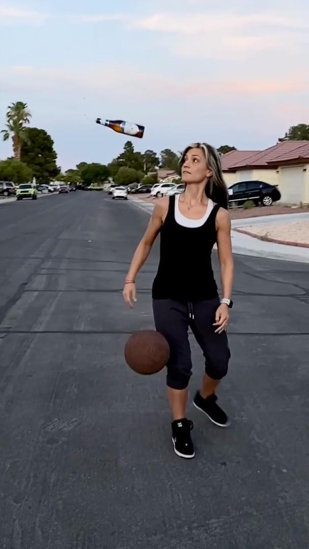 Mom Catches Beer Bottle After Flipping it Off Bouncing Basketball
