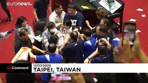 Punches and water balloons thrown in Taiwanese parliament melee