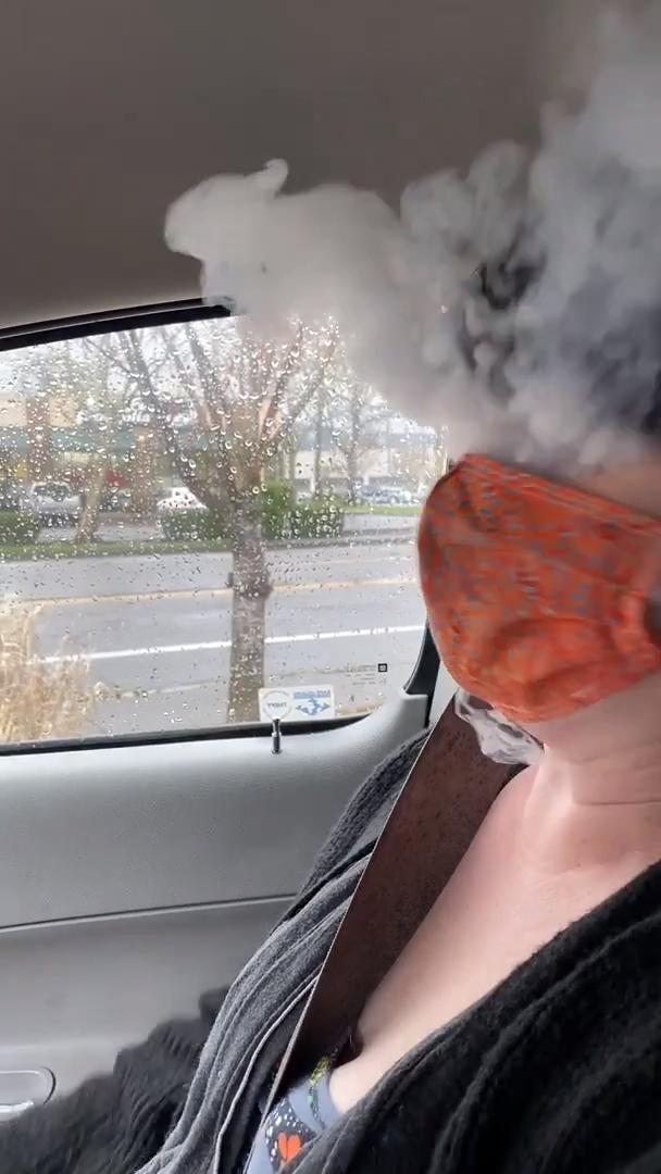 Smoke Billows Out of Mask When Woman Tries to Vape With Mask On