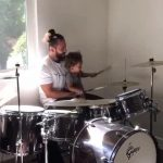 Toddler Plays on Drum Set With His Uncle