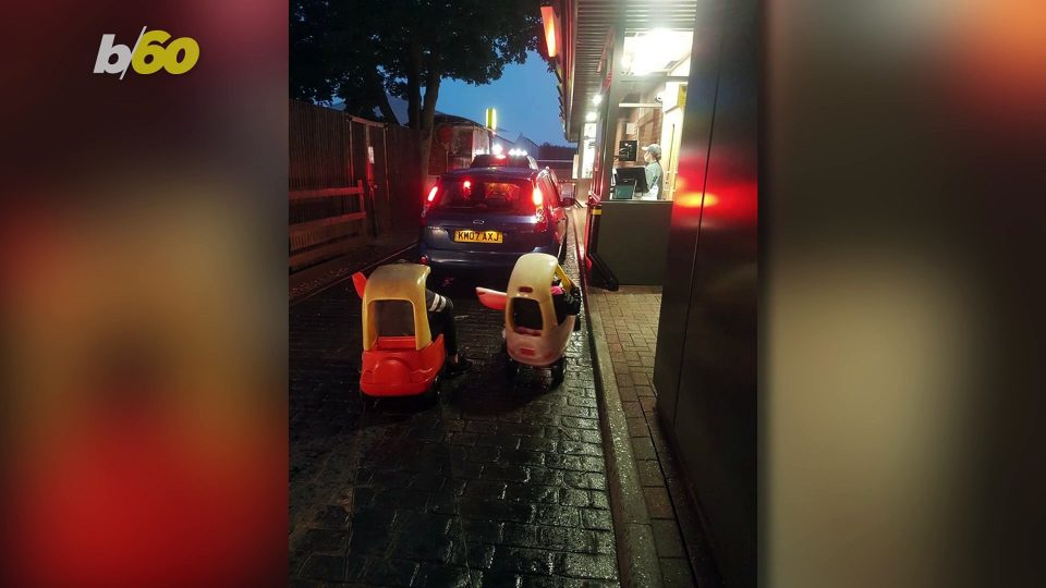 Two Little Girls Awkwardly Drive Toy Cars to Pick Up McDonalds Drive Thru