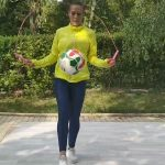 Woman Juggles Football and Jumps Rope Simultaneously