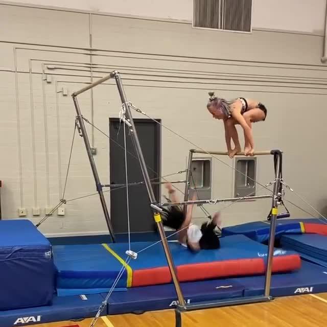 Woman Slips While Climbing Gymnastic Bar and Falls