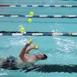 Guy Juggles Balls While Swimming Backwards