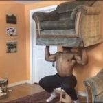 Guy Lifts Sofa Chair During Home Workout While Sheltering in Place