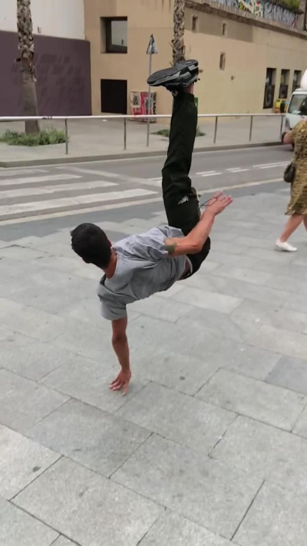 Guy Slips While Skateboarding on Elevated Platform and Falls Hard on Ground