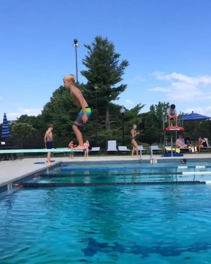 Kid Fails While Diving From Diving Board