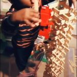 Kid Looks Disappointed After Stick Tower Gets Knocked Over by Him