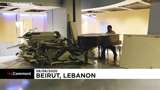 Lebanese student plays piano for volunteers clearing up rubble in Beirut hospital