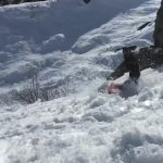 Skier Faceplants and Scorpions Into the Snow While Jumping off Rock