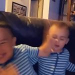 Twin Kids Playfully Slap Each Other